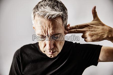 portrait of mature man making shooting