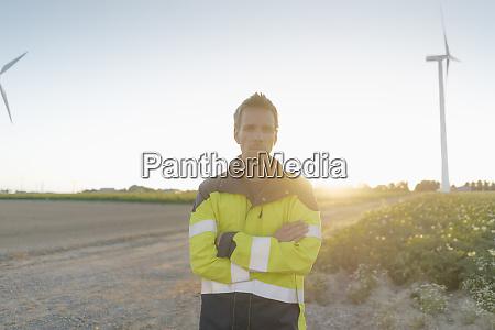 portrait of engineer standing on field