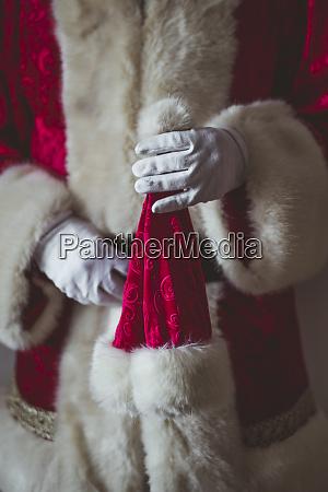 hand of santa claus holding christmas