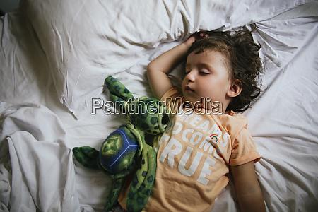 baby girl sleeping on bed with