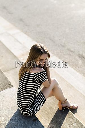 young, woman, wearing, striped, dress, relaxing - 26366156