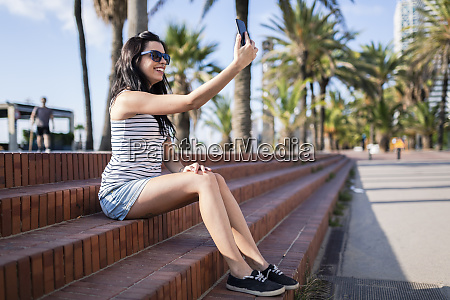 spain barcelona young woman sitting on