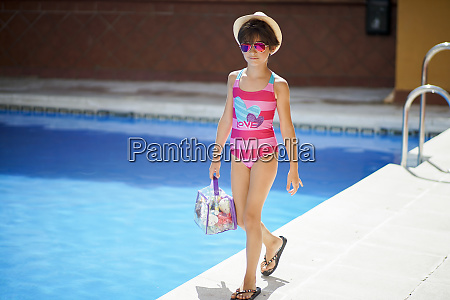 young girl arriving at the pool
