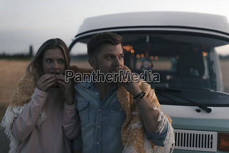 couple wrapped in a blanket at