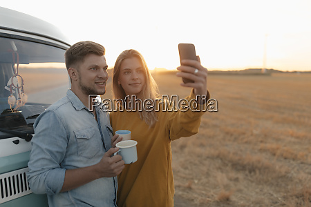 young couple taking a selfie at