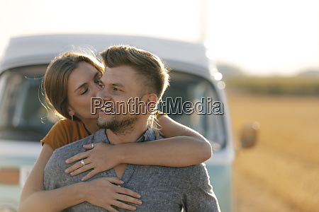happy affectionate young couple at camper