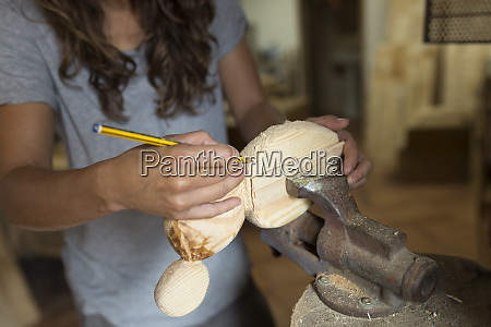 craftswoman working with pencil on a