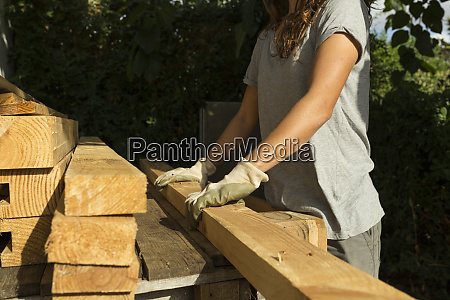 craftswoman wearing protective gloves working with