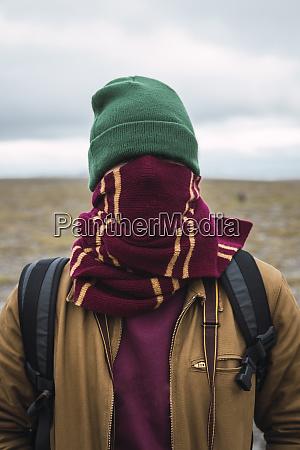 young man with woolly hat and