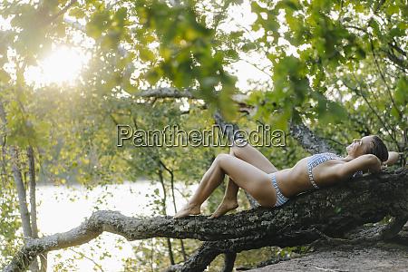 relaxed woman wearing a bikini lying