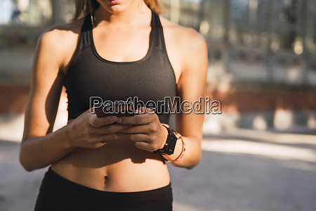 fit young woman with a smartwatch