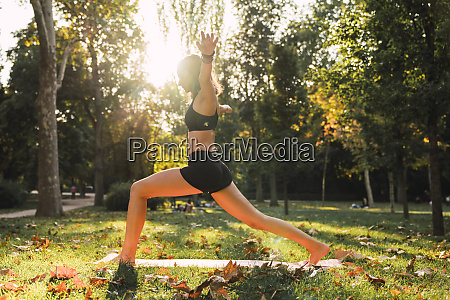 fit young woman practicing yoga in