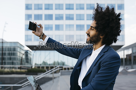 spain barcelona smiling young businessman taking
