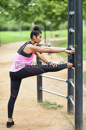 young athlete douning stretching exercises at