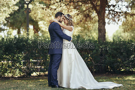 bridal couple standing head to head