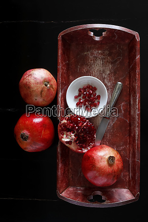 whole pomegranate and pomegranate seed with