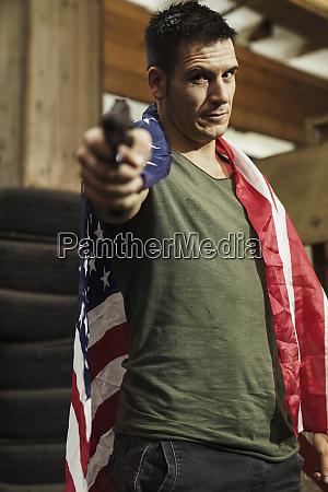 portrait of man wearing american flag