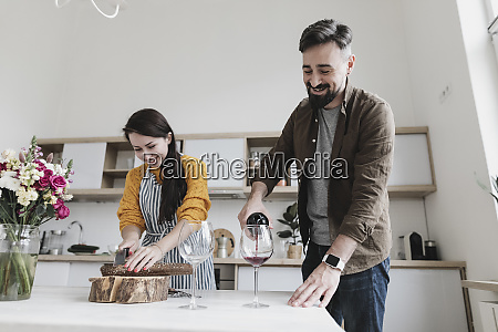 happy couple preparing lunch together in