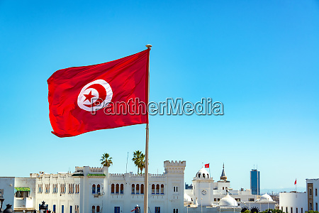 tunisian flag waving in tunis