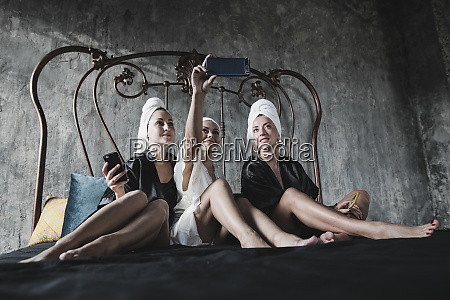 three women with towels around her