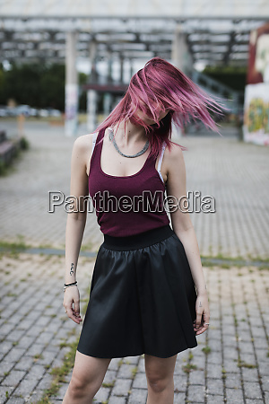 young woman shaking her dyed hair