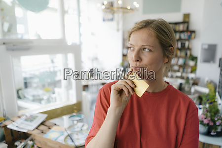 young woman holding card in a