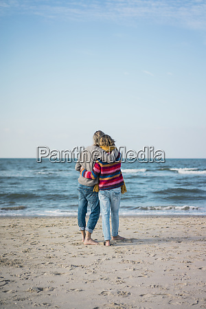 ture couple standing on the beach