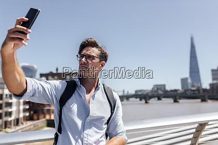uk london man taking a selfie