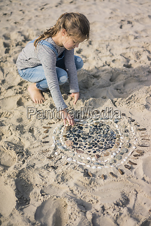 little girl making a heart from