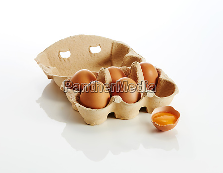 egg box with brown eggs and