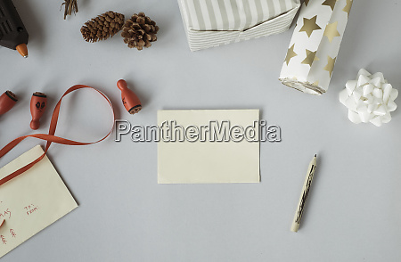 writing christmas cards and wrapping christmas