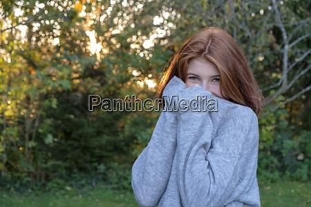 portrait of teenage girl wearing grey