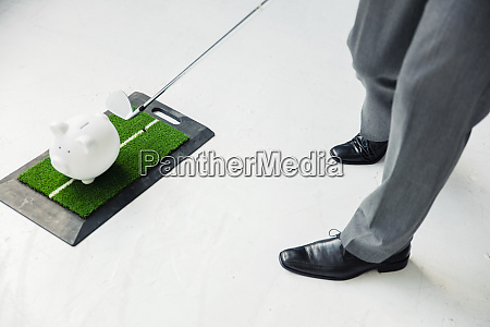 close up of businessman playing golf