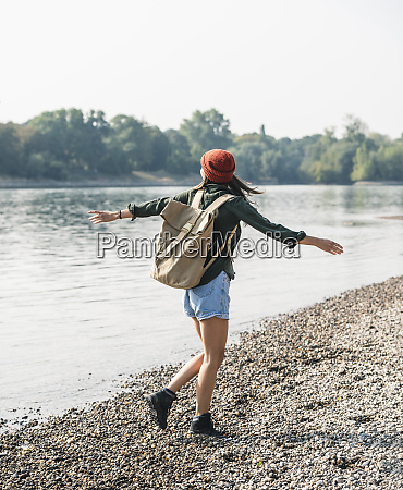 carefree young woman walking at the
