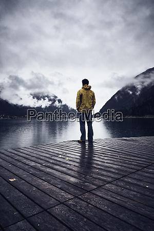 austria tyrol lake achen man standing