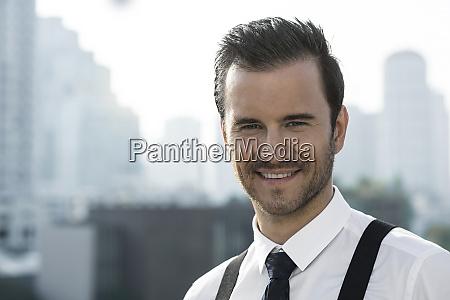 portrait of business man on city