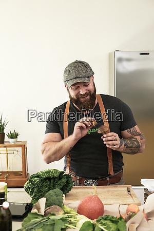 vegan man cleaning mushrooms in his