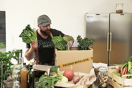 mature man with delivery service packing