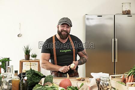 vegan man slicing apples in his