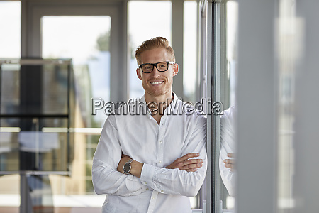 portrait, of, smiling, businessman, in, office - 26392023