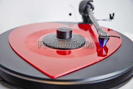 heart shaped vinyl record on record