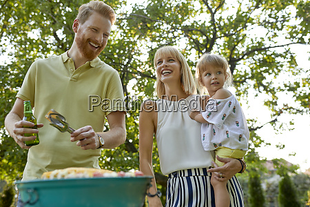 happy family having a barbecue in