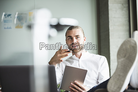 young businessman sitting in office with
