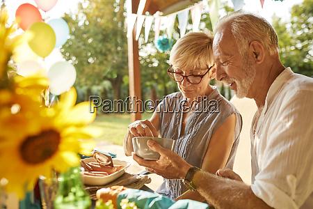 senior couple on a garden party