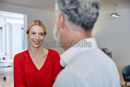 smiling young woman looking at mature