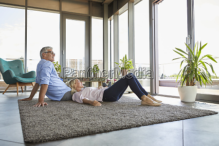 mature couple relaxing at home looking