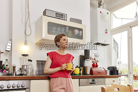 smiling woman having a coffee break