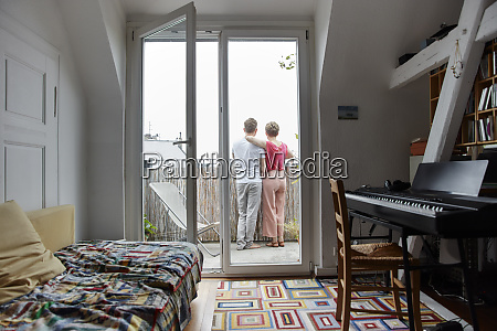 rear view of couple standing on