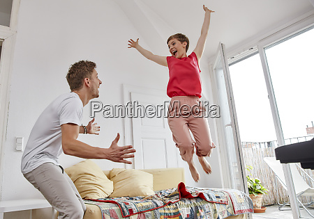 excited couple in living room at