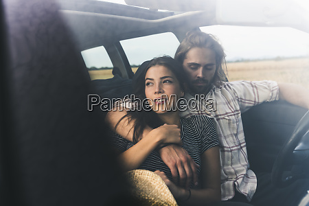 affectionate young couple in a car